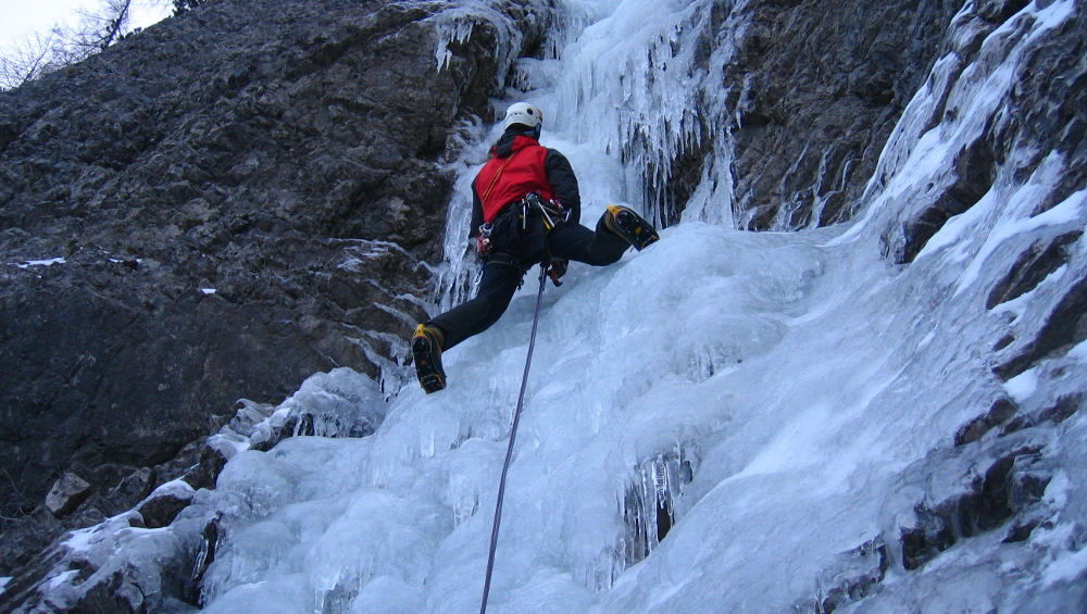 Ice climbing frozen waterfalls and dry-tooling